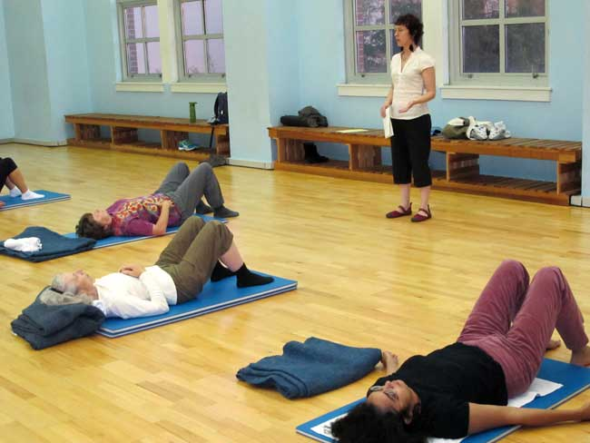 Brandee teaching students in her weekly movement class