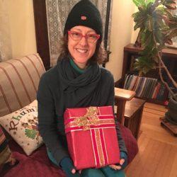 Brandee holding a present