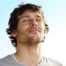Relaxed man breathing fully