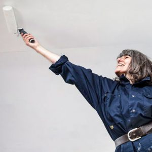 Woman painting a room with ease