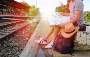Traveller sitting waiting for train