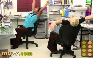 Women dancing in their office chairs