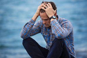 Stressed, overwhelmed man