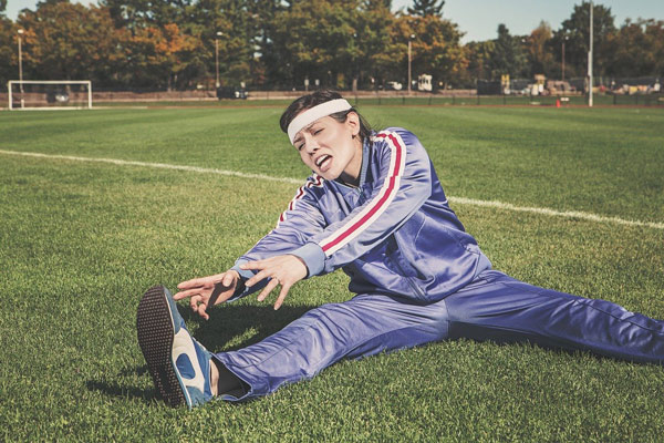 Woman straining to stretch