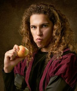Person Chewing Apple