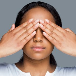 Calm woman covering her eyes